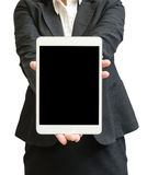Hands of a businesswoman holding blank tablet device Stock Image
