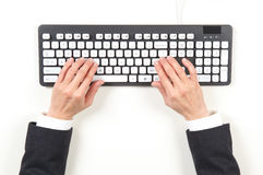 Hands businesswoman and keyboard Stock Image