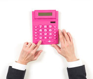 Hands businesswoman and red calculator Stock Photography