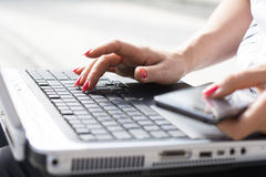 Hands of a businesswoman typing on a computer keyboard Stock Image