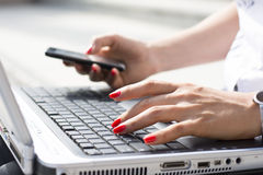 Hands of a businesswoman typing on a computer keyboard Royalty Free Stock Image