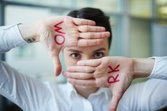 Encourage for work. Hands of businesswoman with word work with her glance between Stock Images