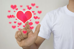 Hands with buttom  hearts. Man touch for Valentine's day. Royalty Free Stock Photo