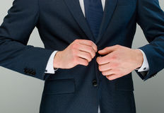 Hands & buttons Stock Photography