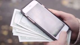 Hands buying goods from the internet on his smartphone with his credit card. stock footage