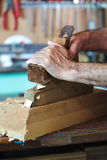 Hands of a cabinetmaker sanding Royalty Free Stock Photography