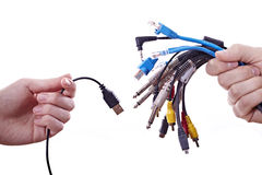 Hands with cables. Woman's hand with a usb cable and men with different cables Royalty Free Stock Image