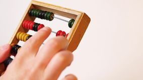 Hands calculate on abacus stock video footage