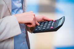 The hands calculating profit on the calculator Royalty Free Stock Photo