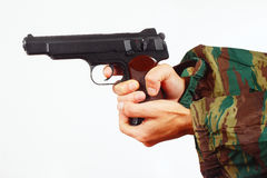 Hands in camouflage uniform with automatic army pistol Stock Photos