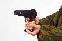 Hands in camouflage uniform with handgun on white background Stock Photos