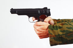 Hands in camouflage uniform with pistol on white background Stock Photos