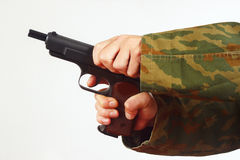 Hands in camouflage uniform reload gun on white background Stock Photography