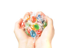 Hands with candies. Child's hands with some sweets isolated on white background Royalty Free Stock Images