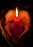 Hands with a candle Stock Image