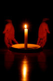 Hands and Candle Stock Photography