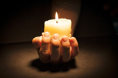 Hands with candle Royalty Free Stock Image