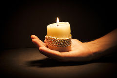 Hands with candle Stock Image