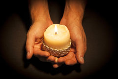 Hands with candle Royalty Free Stock Photo