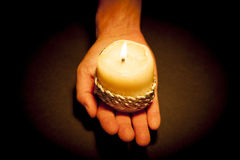 Hands with candle. Praying Hands with candle in black background Royalty Free Stock Photography
