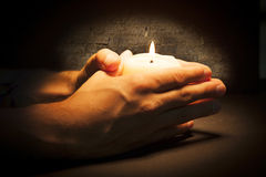 Hands with candle Royalty Free Stock Images