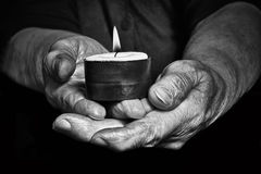 Hands and candle. View of an old woman hands holding a burning candle Stock Photography