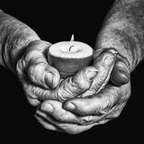 Hands and candle. View of the old woman hands holding a burning candle on a black background Royalty Free Stock Image