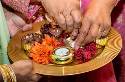 Hands and candles for mendhi henna wedding royalty free stock images