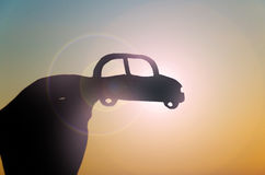 Hands with the car contour on the sun Stock Image