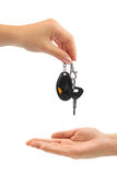 Hands and car key. Isolated on white background Stock Photography