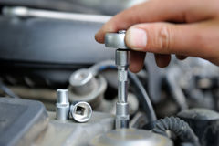 Hands of car mechanic Royalty Free Stock Images