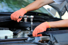 Hands of car mechanic. In auto repair service stock photography