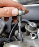 Hands of car mechanic Royalty Free Stock Image