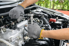 Hands of car mechanic in auto repair stock images