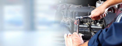 Hands of car mechanic in auto repair service. Hands of car mechanic with wrench in auto repair service Stock Image