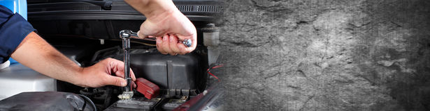 Hands of car mechanic with wrench in garage. Hands of car mechanic with wrench in auto repair service Stock Image