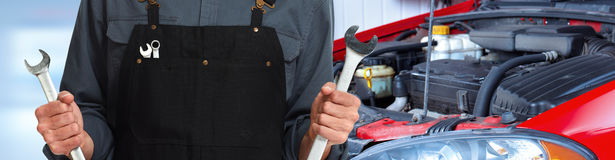 Hands of car mechanic with wrench royalty free stock photography