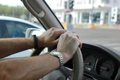 Hands on a car steering wheel Royalty Free Stock Photography