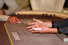 Hands with cards on poker table, selective focus Royalty Free Stock Photo