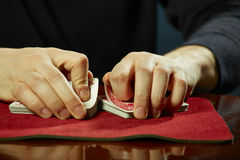 Hands and cards trick Royalty Free Stock Photography