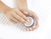 Hands with care cream Stock Photos