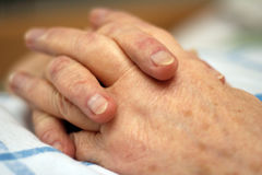 Hands of a care-dependent person. Old wrinkled hands of a care-dependent person stock photos