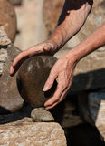 Hands Carefully Balancing Stones Stock Photography
