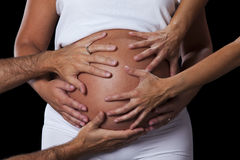 Hands caressing a pregnant belly Stock Images