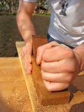 Hands of the carpenter Royalty Free Stock Photography