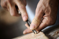 Hands of a carpenter, close up Stock Photos