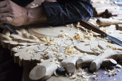 Hands of a carpenter Stock Photos
