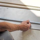 Hands of the carpenter Stock Photos