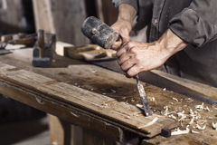 Hands of carpenter plane at work Stock Photo