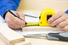 Hands carpenter working Stock Image